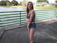 Shy girl poses erotically to take pictures
