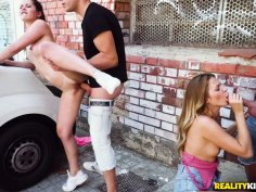 Petite teens enjoy group sex session in a public place