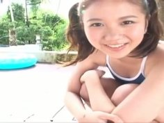 Cute brunette with pigtails poses in swimsuit on cam