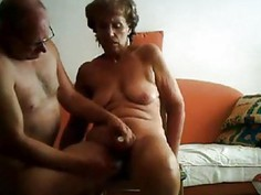 Real mature couple having sex on home sofa