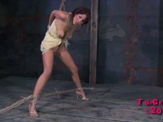 Lavender Rayne is tied up and thrusted in her mouth with a fat strapon